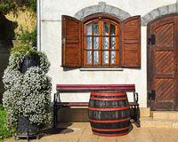 Wooden window and door of an old house. With barrell and bench stock images