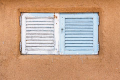 Wooden window embedded in a mud and clay wall Royalty Free Stock Photos
