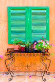 Wooden window with flower pots Stock Photography