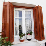 Wooden window and flowerpots. Anafiotika, Athens Greece royalty free stock image