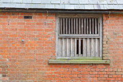 Wooden window frame of farm building Stock Photography
