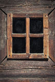 Wooden window frame. On a wooden house Stock Photography