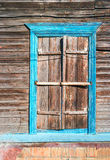 Wooden window with frame painted in blue color Royalty Free Stock Photo