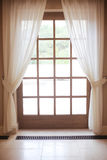 Wooden window frame with white curtain Stock Photography