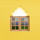 Wooden window frame on the yellow wall Stock Photography