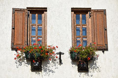 Wooden window frames and flowers Royalty Free Stock Photo