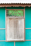 Wooden window with green wall background Stock Photo