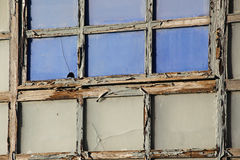 Wooden window of an old house, broken glass. A detailed view of a window with wood frame, from the ruins of an old house in the ancient city of palermo, sicily royalty free stock image