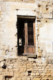 Wooden window of an old house. A detailed view of a window with wood frame, from the ruins of an old house in the ancient city of palermo, sicily, in a stone stock image