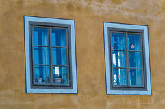 Wooden window on an old house with yellow facade Royalty Free Stock Photography