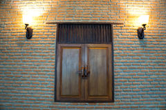Wooden window with old style brick wall Royalty Free Stock Photo