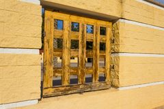 Wooden window in the old style stock photography