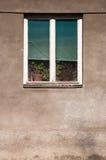 Wooden window on old village house Stock Photo