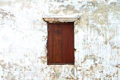 Wooden window on old white texture Royalty Free Stock Photos
