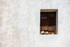 Wooden window on old white wall Royalty Free Stock Images