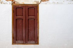 Wooden window on old white wall. Royalty Free Stock Images