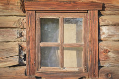Wooden window in the old wooden house. Traditional ethnographic house in the Ukrainian village stock photography