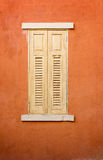 Wooden window on orange concrete wall Royalty Free Stock Image