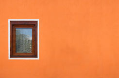 Wooden window on orange  wall Royalty Free Stock Photography