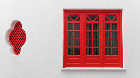 Wooden window with red frames Royalty Free Stock Image