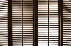 Wooden Window Shutters. Wooden shutters in front of bright, sunlit windows Stock Photography