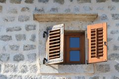 Wooden window with shutters close-up in an old house. Mediterranean Royalty Free Stock Images