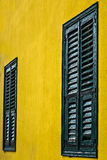 Wooden window shutters. Colored shutters on old house in Athens Stock Photos