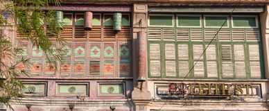 Wooden window shutters - famous local architecture in Georgetown, Penang, Malaysia. Royalty Free Stock Image
