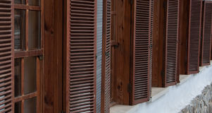 Wooden window with shutters in the long term. High quality Stock Image