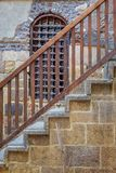 Wooden window and staircase with wooden balustrade leading to historic Beit El Set Waseela building, Old Cairo, Egypt royalty free stock photography