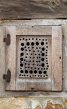 Wooden window on stone wall Royalty Free Stock Photo