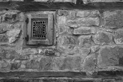 Wooden window on stone wall Royalty Free Stock Photography