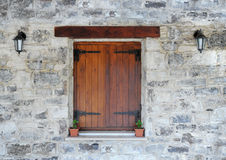 Wooden window in the stone wall Royalty Free Stock Images