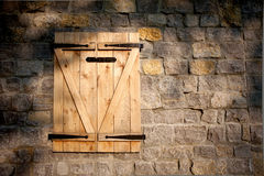 Wooden window and stone wall. With partial shade Royalty Free Stock Photo