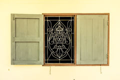 The wooden window with Thai curved steel Stock Photo
