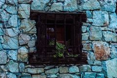 Wooden window in traditional stone house royalty free stock photos