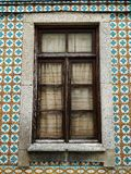 Wooden window of typical portuguese houses, with ceramic tiles on the facade royalty free stock photos