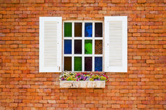 Wooden window on the vintage brick wall Royalty Free Stock Images