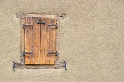 Wooden window on a wall Royalty Free Stock Image