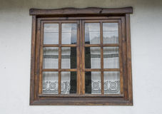 Wooden window with white lace curtains Royalty Free Stock Photo