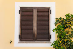 Wooden  window on yellow wall Stock Photography