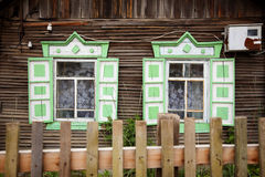 Wooden windows. Typical wooden windows of a house on Lake Baikal in Russia Royalty Free Stock Photo