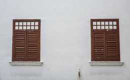 Wooden windows of ancient building royalty free stock photography
