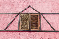 Wooden windows. Brown wooden window on pink wall Stock Photography