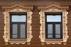 Wooden windows with carved platbands stock images