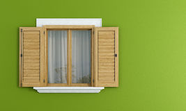 Wooden windows on green wall Stock Photo