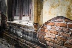 Wooden windows on grunge old wall stock photos