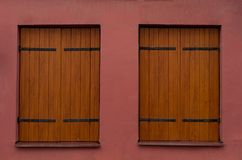 Wooden Windows and Magenta Color Wall. Wooden Window and Magenta Color Wall royalty free stock image