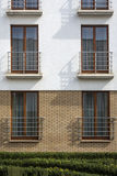 Wooden windows in multi family house Stock Photography