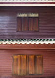 Wooden windows of vintage two-storey house Stock Images